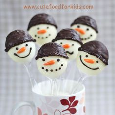 Cute Christmas Desserts | Draw facial details and hats on the snowmen with melted chocolate