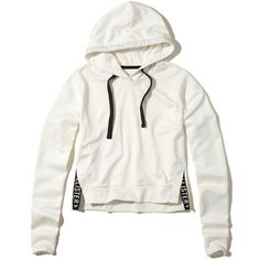 Hollister Logo Crop Hoodie ($15) ❤ liked on Polyvore featuring tops, hoodies, white, side slit top, cropped hooded sweatshirt, sweatshirt hoodies, logo hoodies and white cropped hoodie