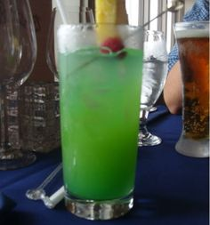 Sunken Treasure  (1 oz Malibu coconut Rum 1 oz Midori 1 oz Orange juice 1 oz Pineapple juice .5 oz Curacao Splash of Sprite)