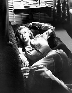 Marilyn Monroe in her breakthrough film, the crime noir The Asphalt Jungle Though she only had a small part in it, as gangster moll Angela, she made an impression on audiences and studio honchos, and soon was offered larger roles. Lauren Bacall, Cary Grant, Fotos Marilyn Monroe, Gerard Philipe, Photo Star, John Huston, Actor Studio, Dark City, Norma Jeane