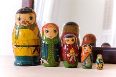 i want a set of vintage nesting dolls SOOO BAD!  i love the style, color and variety of this set.