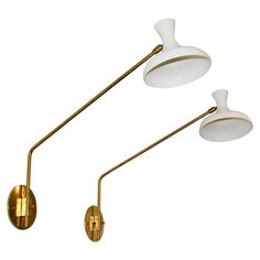 Pair of Stilnovo Swing Arm Sconces | From a unique collection of antique and modern wall lights and sconces at https://www.1stdibs.com/furniture/lighting/sconces-wall-lights/