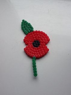 Poppy made with Hama Beads Perler Bead Designs, Hama Beads Design, Hama Beads Patterns, Perler Bead Art, Beading Patterns, Fuse Beads, Pearler Beads, Hamma Beads Ideas, Christmas Perler Beads