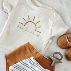 Sunkissed organic onesie, seafoam, clay, baby, boy, girl, unisex, gender neutral, infant, toddler, newborn, bodysuit, layette, onsie, onzie, onesies, one piece, child tee, boho, baby shower gift, cream, natural, organic baby clothes, outfits, Valentine's Day, word onesie, typewriter font clothes, wholesale, tenth & pine, tenth and pine Baby Quotes, Baby Sayings, Gender Neutral Baby Clothes, Bodysuit, Organic Baby Clothes, Unisex, Baby Wearing, Baby Shower Gifts, Onesies