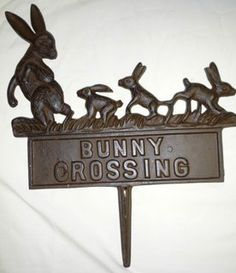 """Cast Iron Bunny Crossing Stake by Trade Routes NW. $15.99. 13 3/4"""" high x 13"""". Cast iron sign. Powdercoated brown color. Bunny family design. Our hilarious powdercoated brown Cast Iron """"Bunny Crossing"""" Stake  stands 13 3/4"""" high including the stake x 13"""" long x 1/2"""" thick. Wherever you decide to place it in your yard, it will bring a smile to all!"""