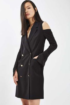 A smart staple gets a party-ready makeover. This chic blazer dress features cool cut-out detail to the shoulders, a small slit to the sleeves and contrast buttons. Dress up with strappy heels for a polished look. #Topshop