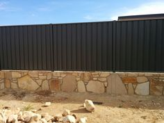 Colorbond fence on our sandstone retaining wall