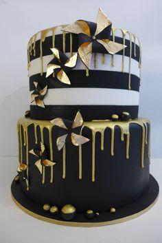 Gold Drip cake, Black, gold and white Birthday cake. Dramatic wedding cake. black and gold pinwheels, gold leaf pinwheels. alternative wedding cake.