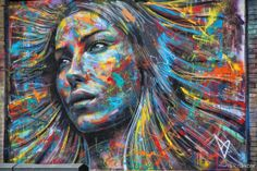This amazing picture is by David Walker, and as the title suggests, he did not use any brushes or stencils. This is very unusual for a street artist to do, mostly because it is so difficult. The girl is made up of vibrant colors, while still remaining amazingly realistic – making the overall effect quite incredible.
