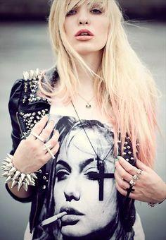 Studded back leather jacket. Black cross necklace. Studded bracelet. Woman smoking a cig shirt. Rock n roll style.