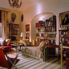 decordesignreview:  brass bookcases and daybed in this sophisticated sitting room