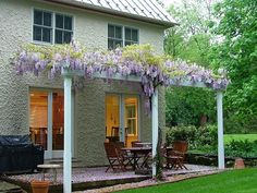 Love the wisteria framing the entrance