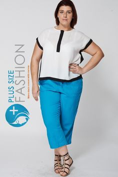 """Teal 3/4 Linen Trousers Who said you can't look your best cause are plus size! This will go with any top or blouse of your choice .    Key Features:  - Waist Tie  - 3/4 Lenght Leg  - Loose Fit  - Front and Back Pockets  Material:  - 52% Linen  - 48% Viscose  Measurements:  - Model is 5""""8' and wears UK18  - Waist on one side Approx. 48.5cm  - Inner Leg Approx. 55cm  - From Waist to Hem Approx. 83cm 