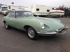 - The Third Rarest Jaguar E-Type - 1967 JAGUAR E-TYPE FIXED HEAD COUPE 4.2 (unrestored) - Front Right Three-Quarters View .. this car is one of only 75 built from the end of Series 1 production run and prior to the Series 1-1/2, rare E-Types with open headlights .... This willow green car has matching numbers.