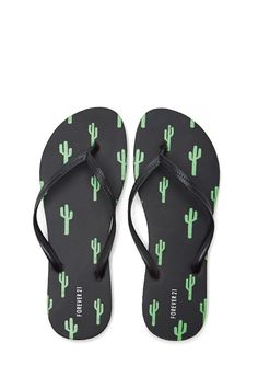 A pair of flip flops featuring a cactus print and a ridged sole.