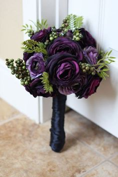 What about something like this for bridesmaids but without the green? Or even black roses if they are still in purple dresses