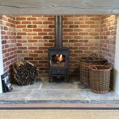 Most current Images Brick Fireplace log burner Style It often makes sense to be able to omit the actual upgrade! Rather then taking out a obsolete brick fireplace , cut cost ideas log burner Brick Fireplace Log Burner, Inglenook Fireplace, Fireplace Design, Fireplace Ideas, Country Fireplace, Fireplace Hearth Stone, Brick Hearth, Fireplace Lighting, Rustic Fireplaces