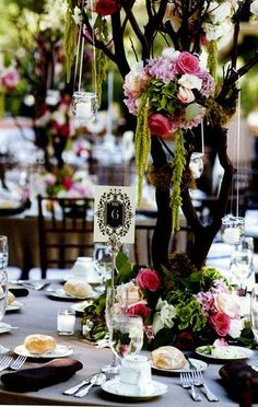 Centerpiece made with tall branches and hanging flowers