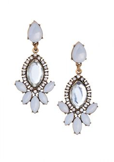 White stone drop earrings with a crystal stone in the center. These statement earrings are the perfect way to dress up any outfit.