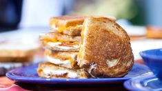 Three cheese grilled cheese and roasted tomato soup - The combination of a good cheddar and mozzarella makes for the gooiest, meltiest grilled cheese.