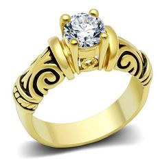 This ring features tribal patterns crafted in brass and ion coated in gold all to hold a AAA grade 1.5 carat cubic zirconia stone with a flawless shine.