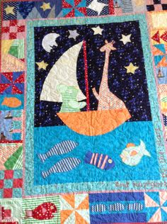 At long last this quilt is finished and has gone to its new owner. And I am so thrilled that he loves it and even took it to the bathroom with him when he cleaned his teeth!