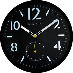 This NeXtime bold, black clock design with convex glass has an avionic look, slightly reminiscent of the dials found on cockpit instruments. 3050 - Serious Black
