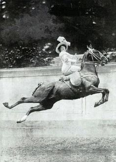 Leaping Horse while riding Sidesaddle and wearing a corset. That woman is amazing. Early 20th century