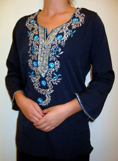 This Navy Tunic is a  delight in soft Navy georgette fabric that is a huge customer favorite, with intricate elegant embellishment