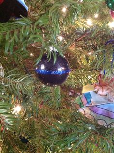 Set of black ornaments from Walmart, glue, and glitter. The thin blue line. Law enforcement