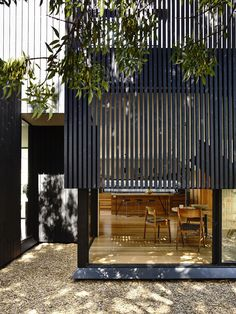 Wooden slats filter in sunlight and give the homeonwers adequate privacy
