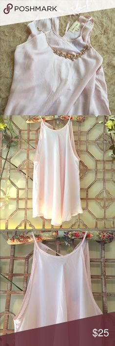 NWT Anthropology pink cami with tie strings This romantic shabby chic pink pastel colored cami top is pretty enough for daytime and chic enough for a night out. Material is soft and is machine wash Anthropologie Tops Camisoles