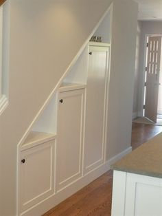 Under the stairs storage - basement remodel.  Excellent use of space!