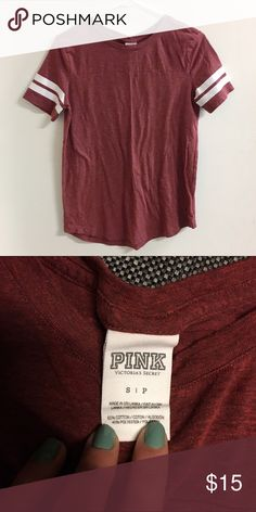 PINK Victoria's Secret Shirt Super comfy Victoria's Secret Tee. Maroon red and has cute stripes on the sleeve for a sporty look. In great condition! PINK Victoria's Secret Tops Tees - Short Sleeve