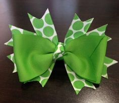 A 5 inch green grosgrain hair bow with green and white polka dot spikes by BrinleysBowtique32, $7.00