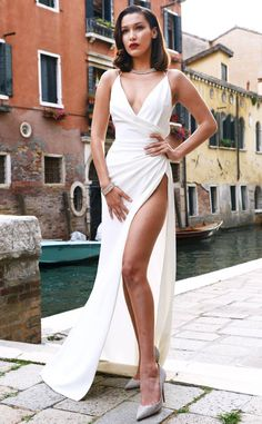 Bella Hadid from The Big Picture: Today's Hot Photos  Ciao Bella! The model looks statuesque in an all white dress during a photo shoot in Venice, Italy.