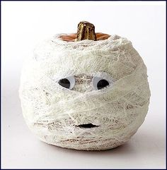 Gauzy-Glow Pumpkin - When darkness falls, this shrouded pumpkin lights up and casts an eerie aura. The secret? Cheesecloth brushed with glow-in-the dark paint.
