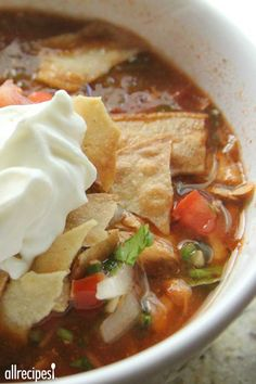 A quick, no-fuss version of chicken tortilla soup! All you do is put everything into the slow cooker, and turn it on. Then garnish with baked corn tortilla strips! Crock Pot Slow Cooker, Crock Pot Cooking, Pressure Cooker Recipes, Slow Cooker Chicken, Crockpot Recipes, Soup Recipes, Chicken Recipes, Cooking Recipes, Healthy Recipes