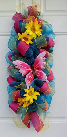 This is a 31 Spring/ Summer Turquoise Butterfly Mesh Swag Wreath, accented with yellow mesh ribbon, pink burlap ribbon and tin butterfly on a pine Deco Mesh Crafts, Wreath Crafts, Diy Wreath, Burlap Wreath, Burlap Ribbon, Wreath Ideas, Easter Wreaths, Holiday Wreaths, Diy Ostern