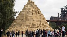 #omg #wtf:The #world's highest #sandcastle is now standing 16.68 meters (54.72 feet) tall in the #German city of Duisburg. A German travel operator organized the construction of the mammoth sandcastle, bringing in 3,500 tons of sand over the past 3 ? weeks to the site at a former steelworks in the...