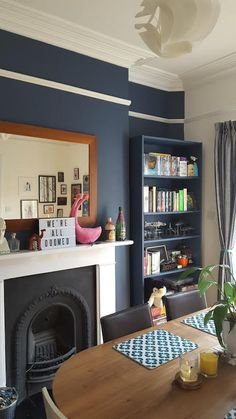 Don't like the dark part above picture rail. Dulux Breton Blue walls and painted Ikea Billy bookcase (also painted in Breton Blue). MADE Edelweiss dining table. Living Room Paint, New Living Room, Home And Living, Living Room Decor, Living Spaces, Dining Room Blue, Dining Table, Blue Rooms, Blue Walls