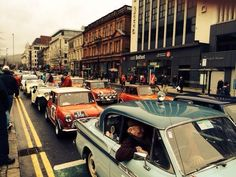 A cavalcade of minis pass #VisitBelfast Welcome Centre during the Paddy Hopkirk Gala, 2014