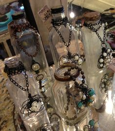 bottles as jewellery display!  we could think of buying more glass products and double them up with jewellery displays - just a thought