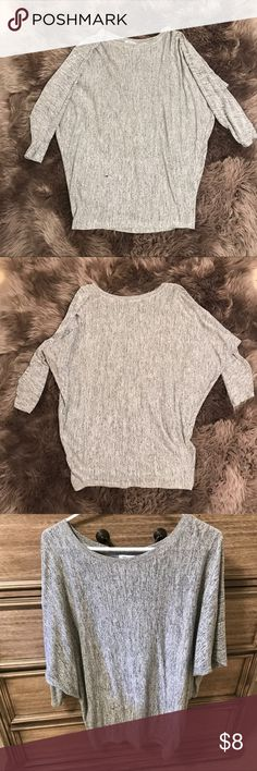 Grey Tunic This Grey Tunic is long sleeved. In excellent condition. Size: M Tops Tunics