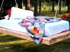 Make Your Own Hanging Daybed - Outdoor Lounging Spaces: Daybeds, Hammocks, Canopies and More on HGTV.I could see my self sleeping here. Daybed Outdoor, Diy Outdoor Furniture, Outdoor Rooms, Diy Furniture, Outdoor Swings, Porch Swings, Wicker Furniture, Bed Swings, Patio Daybed