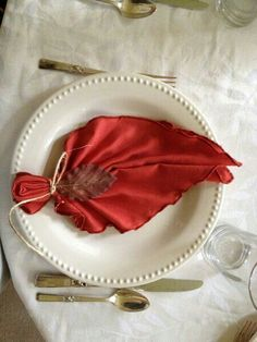 Cute Way To Display Napkins For A Fall Wedding or Fall Dinner Party - Leaf Napkin Folding - Video Tutorial Shows How To Do The Fold. Just Add The Twine & Little Leaf :)