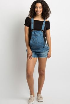 Blue Frayed Denim Overall Shorts Denim maternity overall shorts featuring distressed details, a frayed hem, adjustable shoulder snap buckle straps, and a top front pocket with a mini pocket accent. Additional details include a square neckline, four pockets, belt loops, and a triple side button closure. This style was created to be worn before, during, and after pregnancy. Maternity Romper, Pink Blush Maternity, Stylish Maternity, Maternity Fashion, Overalls Fashion, Baby Bump Style, Maternity Skinny Jeans, One Piece Outfit, Overall Shorts