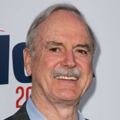 Visit Biography.com to see how John Cleese, most famous for his work with Monty Python and the popular British TV series <i>Fawlty Towers</i>, first got his start in comedy.