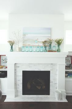 Mantel, marble tile surround, low shelves on side