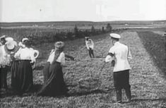Tsar Nicholas II, holding a camera, watches as his daughters have fun with the officers on their summer holiday in the 1910s.A♥W